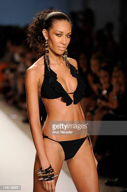 A model walks the runway during the Red Carter fashion show on July 22 2012 in Miami Beach Florida