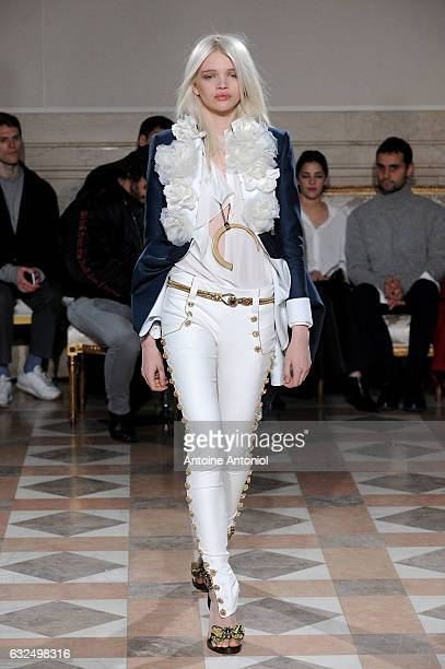 A model walks the runway during the Redemption Couture Spring Summer 2017 show as part of Paris Fashion Week on January 23 2017 in Paris France