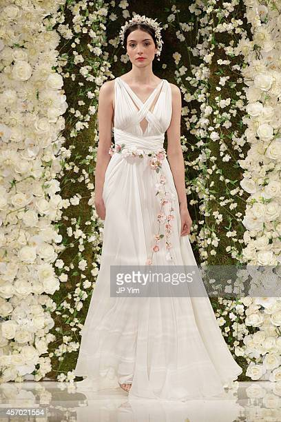 Model walks the runway during the Reem Acra Fall 2015 Bridal Collection show at the Reem Acra Boutique on October 10, 2014 in New York City.
