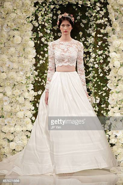 A model walks the runway during the Reem Acra Fall 2015 Bridal Collection show at the Reem Acra Boutique on October 10 2014 in New York City