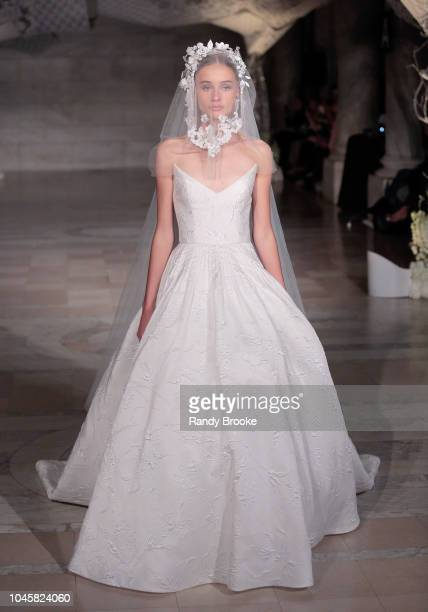 A model walks the runway during the Reem Acra Fall/Winter 2019 bridal show at New York Fashion Week Bridal on October 4 2018 in New York City