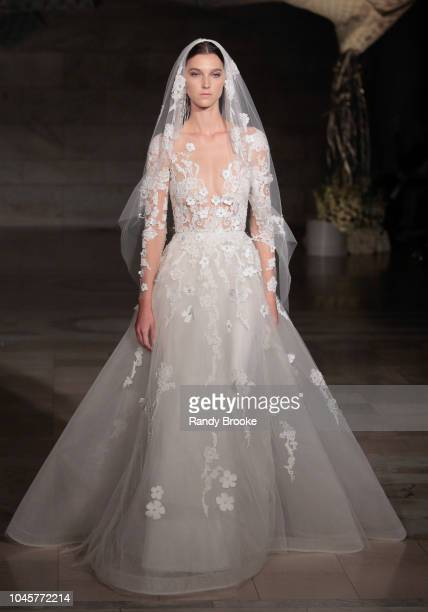 Model walks the runway during the Reem Acra Fall/Winter 2019 New York Fashion Week: Bridal on October 4, 2018 in New York City.