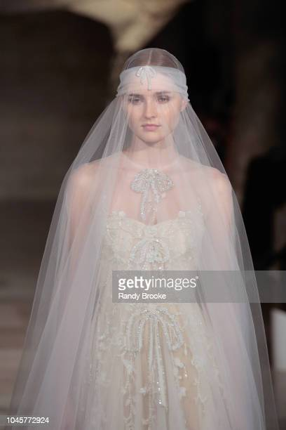 A model walks the runway during the Reem Acra Fall/Winter 2019 New York Fashion Week Bridal show on October 4 2018 in New York City