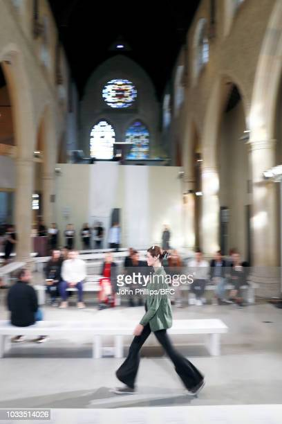 A model walks the runway during the rehearsal ahead of the Eudon Choi show during London Fashion Week September 2018 at the Garden Museum on...