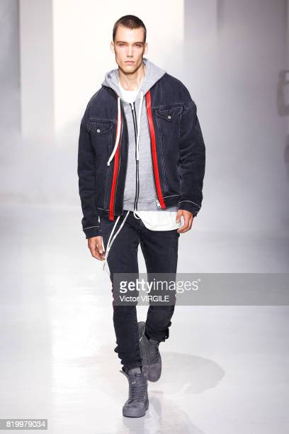 Model walks the runway during the Represent show during NYFW: Men's July 2017 Spring Summer 2018 at Skylight Clarkson Sq on July 13, 2017 in New York...