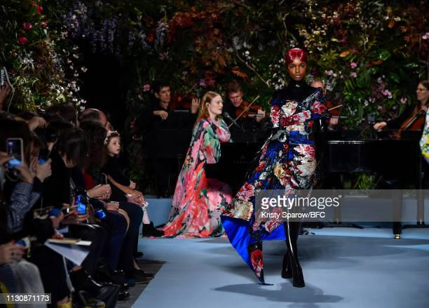 Model walks the runway during the Richard Quinn show as part of London Fashion Week February 2019 at Ambika P3 on February 19, 2019 in London,...