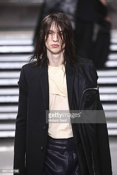 A model walks the runway during the Rick Owens Menswear Fall/Winter 20172018 show at Palais de Tokyo as part of Paris Fashion Week on January 19 2017...