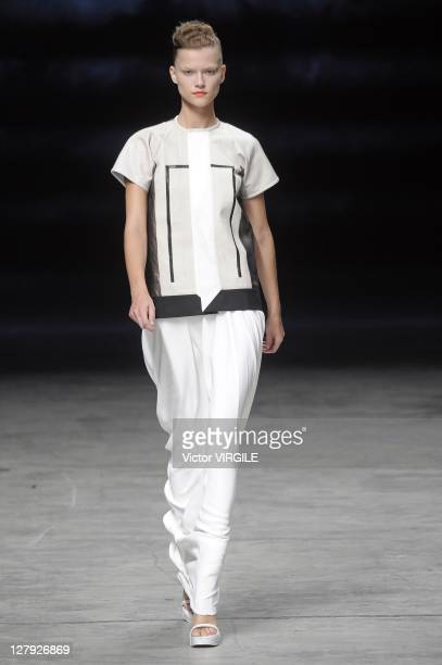 Model walks the runway during the Rick Owens Ready to Wear Spring / Summer 2012 show during Paris Fashion Week at Palais Omnisports de Bercy on...