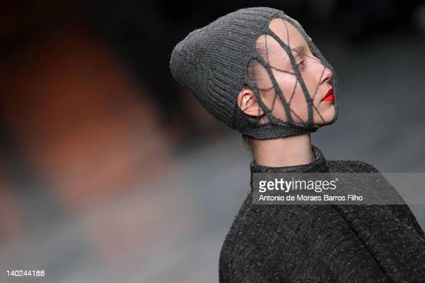 Model walks the runway during the Rick Owens Ready-To-Wear Fall/Winter 2012 show as part of Paris Fashion Week at Palais Omnisports de Bercy on March...