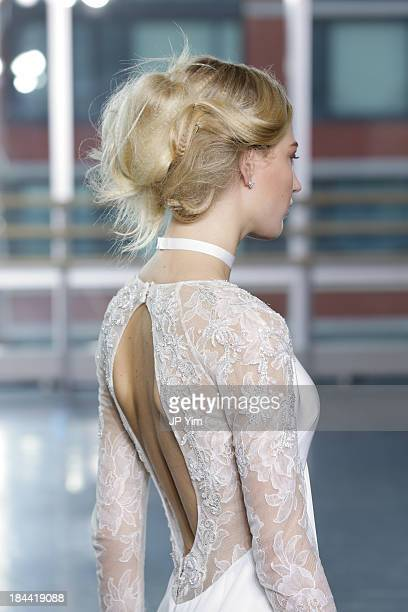 A model walks the runway during the Rita VinierisRivini Fall 2014 Bridal Collection at Alvin Alley Studios on October 13 2013 in New York City