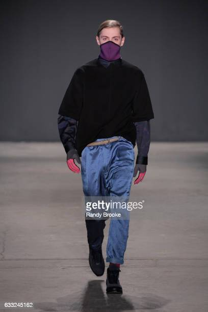 Model walks the runway during the Robert Geller NYFW: Men's show at Skylight Clarkson North on January 31, 2017 in New York City.