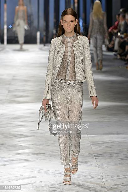 A model walks the runway during the Roberto Cavalli show as a part of Milan Fashion Week Womenswear Spring/Summer 2014 on September 21 2013 in Milan...