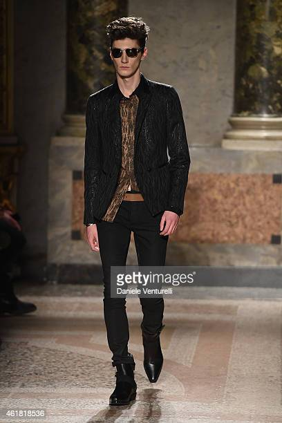 19ebdb958a A model walks the runway during the Roberto Cavalli show as a part of Milan  Menswear
