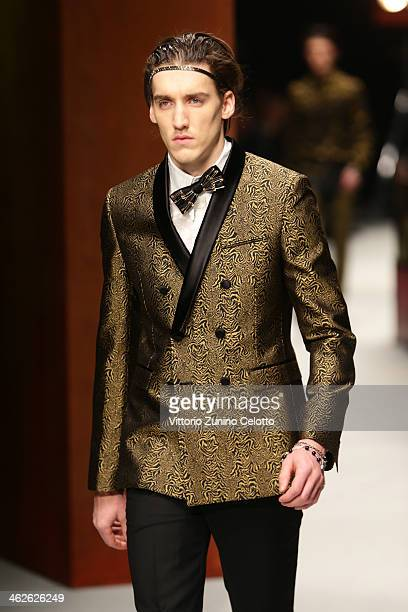 A model walks the runway during the Roberto Cavalli show as a part of Milan Fashion Week Menswear Autumn/Winter 2014 on January 14 2014 in Milan Italy
