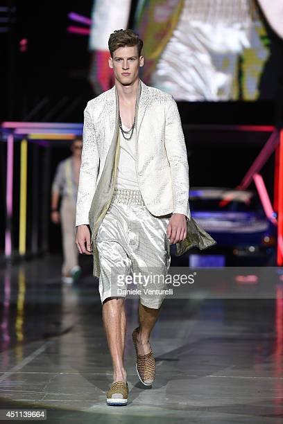A model walks the runway during the Roberto Cavalli show as part of Milan Fashion Week Menswear Spring/Summer 2015on June 24 2014 in Milan Italy