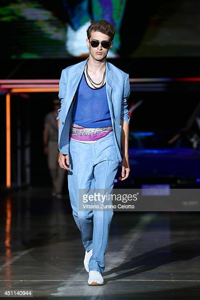 A model walks the runway during the Roberto Cavalli show as part of Milan Fashion Week Menswear Spring/Summer 2015 on June 24 2014 in Milan Italy