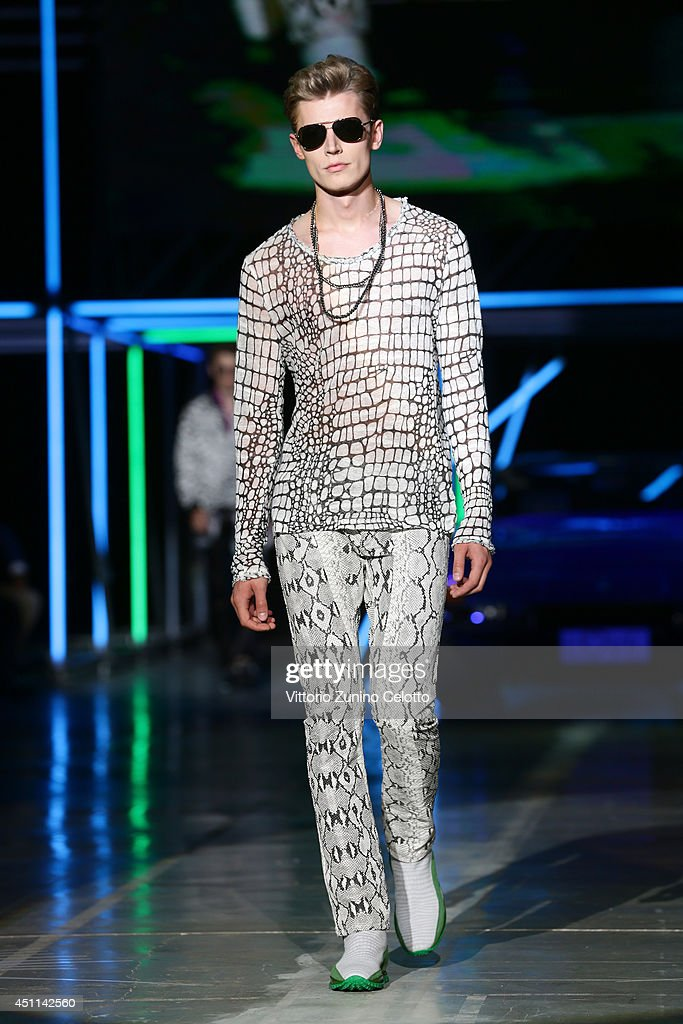A model walks the runway during the Roberto Cavalli show as part of Milan Fashion Week Menswear Spring/Summer 2015 on June 24, 2014 in Milan, Italy.