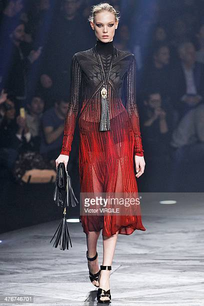 A model walks the runway during the Roberto Cavalli show as part of Milan Fashion Week Womenswear Autumn/Winter 2014 on February 22 2014 in Milan...