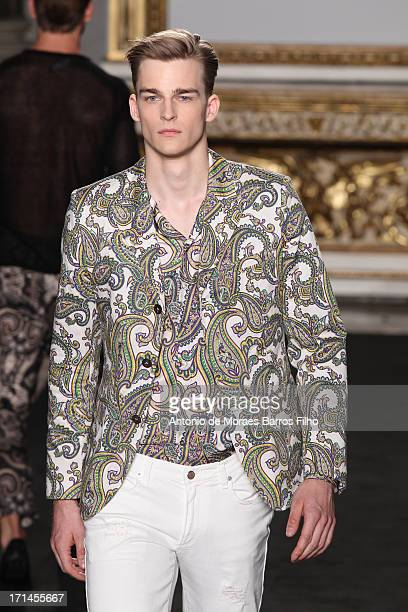 A model walks the runway during the Roccobarocco show as a part of MFW S/S 2014 on June 24 2013 in Milan Italy
