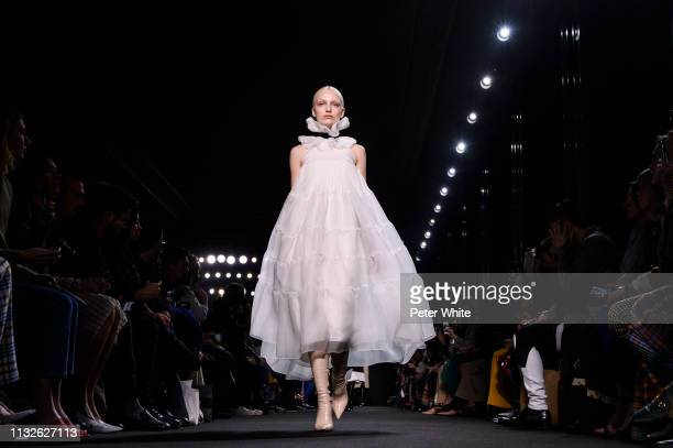 A model walks the runway during the Rochas show as part of the Paris Fashion Week Womenswear Fall/Winter 2019/2020 on February 27 2019 in Paris France