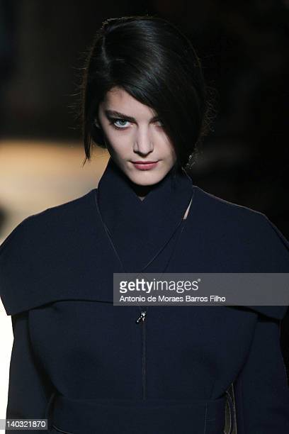 Model walks the runway during the Roland Mouret Ready-To-Wear Fall/Winter 2012 show as part of Paris Fashion Week at Hotel Westin on March 2, 2012 in...