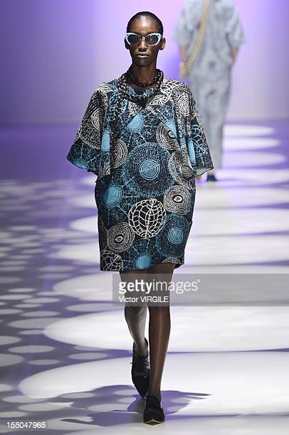 A model walks the runway during the Ronaldo Fraga Fall/Winter 2013 collection at Sao Paulo Fashion Week on October 29 2012 in Sao Paulo Brazil