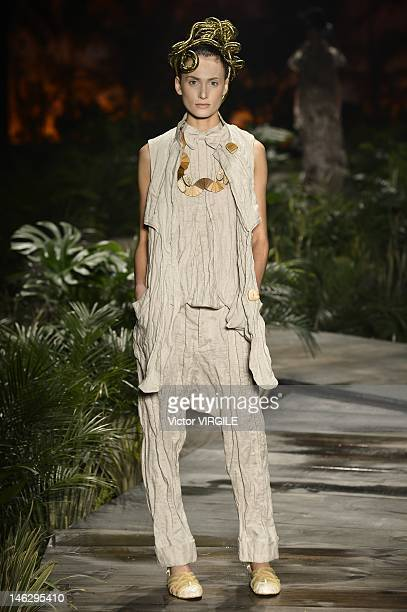 A model walks the runway during the Ronaldo Fraga show as part of the Sao Paulo Fashion Week Spring Summer 2013 on June 12 2012 in Sao Paulo Brazil