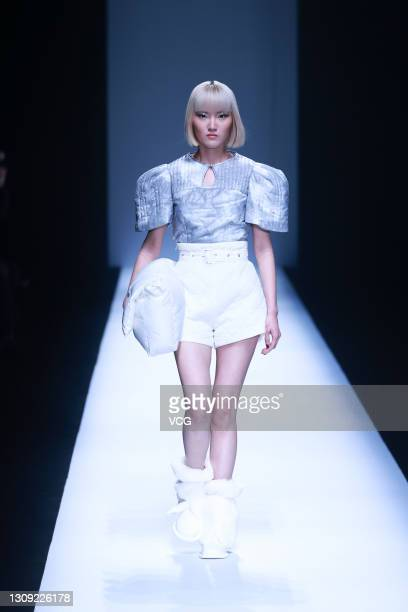 Model walks the runway during the Rongwujie collection show by Chinese designer Xiao Hua on day three of China Fashion Week A/W 2021/2022 at...