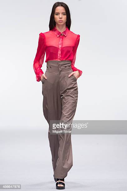A model walks the runway during the Royal Closet Show as part of MercedesBenz Fashion Week Mexico Spring/Summer 2015 day 4 at Campo Marte on October...