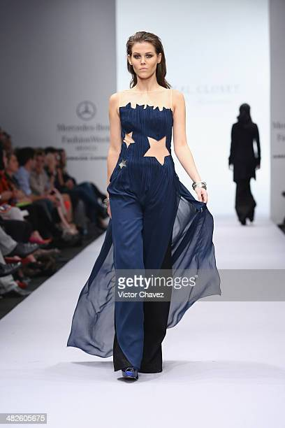A model walks the runway during the Royal Closet show at MercedesBenz Fashion Week Mexico Autumn/Winter 2014 at Campo Marte on April 3 2014 in Mexico...