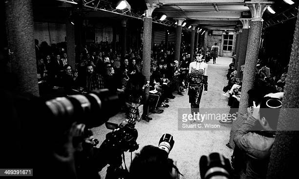 A model walks the runway during the run through at the Fyodor Golan Show during London Fashion Week AW14