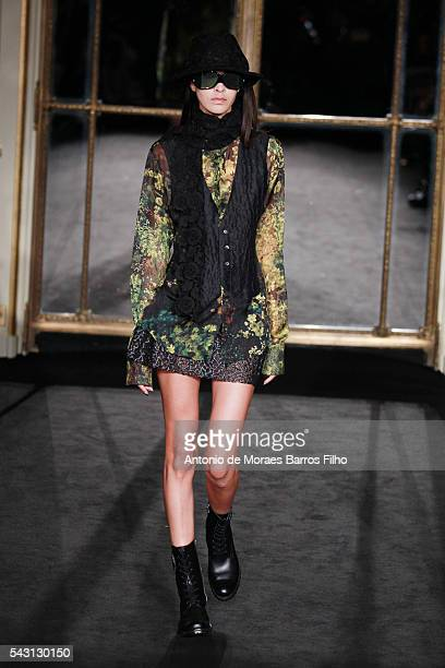 A model walks the runway during the Rynshu Menswear Spring/Summer 2017 show as part of Paris Fashion Week on June 26 2016 in Paris France