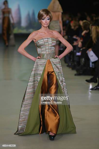 A model walks the runway during the Sabrina Persechino fashion show as part of AltaRoma Fashion Week Spring/Summer 2014 at Santo Spirito in Sassia on...