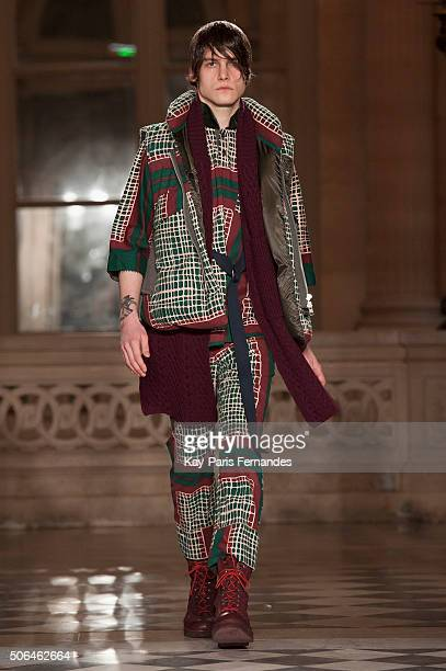A model walks the runway during the Sacai Menswear Fall/Winter 20162017 show as part of Paris Fashion Week on January 23 2016 in Paris France