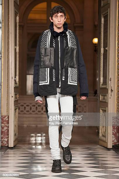 Model walks the runway during the Sacai Menswear Fall/Winter 2016-2017 show as part of Paris Fashion Week on January 23, 2016 in Paris, France.