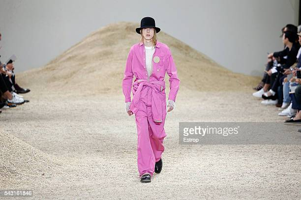 A model walks the runway during the Sacai Menswear Spring/Summer 2017 show designed by Chitose Abe as part of Paris Fashion Week on June 25 2016 in...