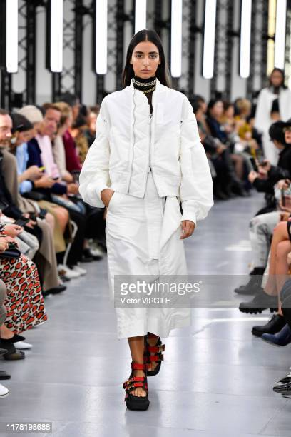 Model walks the runway during the Sacai Ready to Wear Spring/Summer 2020 fashion show as part of Paris Fashion Week on September 30, 2019 in Paris,...