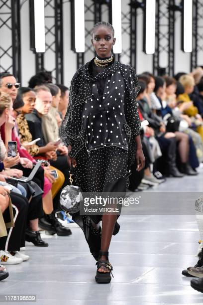A model walks the runway during the Sacai Ready to Wear Spring/Summer 2020 fashion show as part of Paris Fashion Week on September 30 2019 in Paris...