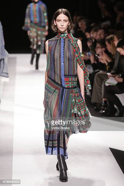 Model walks the runway during the Sacai show as part of the Paris Fashion Week Womenswear Fall/Winter 2014-2015 on March 3, 2014 in Paris, France.