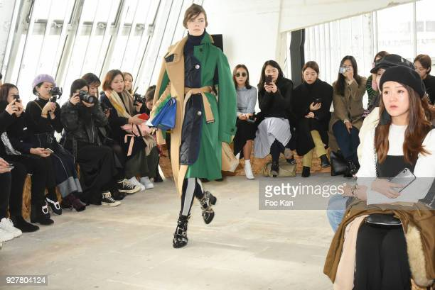 Model walks the runway during the Sacai show as part of the Paris Fashion Week Womenswear Fall/Winter 2018/2019 on March 52018 in Paris France