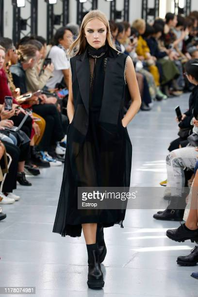 Model walks the runway during the Sacai Womenswear Spring/Summer 2020 show as part of Paris Fashion Week on September 30, 2019 in Paris, France.
