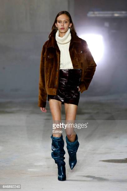 A model walks the runway during the Saint Laurent designed by Anthony Vaccarello show as part of the Paris Fashion Week Womenswear Fall/Winter...
