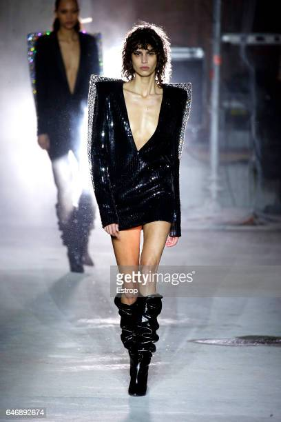 Model walks the runway during the Saint Laurent designed by Anthony Vaccarello show as part of the Paris Fashion Week Womenswear Fall/Winter...