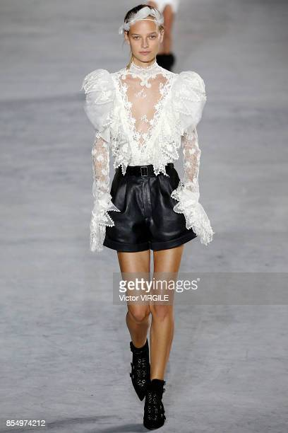 A model walks the runway during the Saint Laurent Ready to Wear Spring/Summer 2018 fashion show as part of the Paris Fashion Week Womenswear...