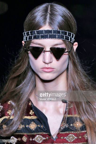 Model walks the runway during the Saint Laurent Ready to Wear fashion show as part of the Paris Fashion Week Womenswear Spring/Summer 2019 on...