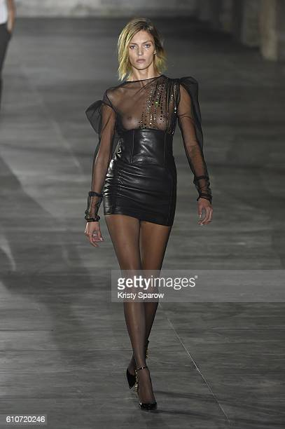 A model walks the runway during the Saint Laurent show as part of Paris Fashion Week Womenswear Spring/Summer 2017 on September 27 2016 in Paris...