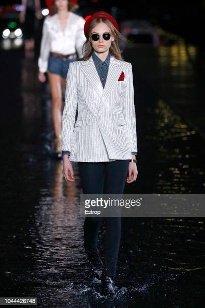 A model walks the runway during the Saint Laurent show as part of the Paris Fashion Week Womenswear Spring/Summer 2019 on September 25 2018 in Paris...