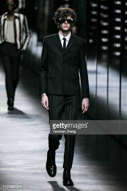 Model walks the runway during the Saint Laurent show as part of the Paris Fashion Week Womenswear Fall/Winter 2019/2020 on February 26, 2019 in...