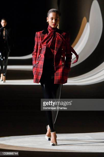 Model walks the runway during the Saint Laurent show as part of the Paris Fashion Week Womenswear Fall/Winter 2020/2021 on February 25, 2020 in...