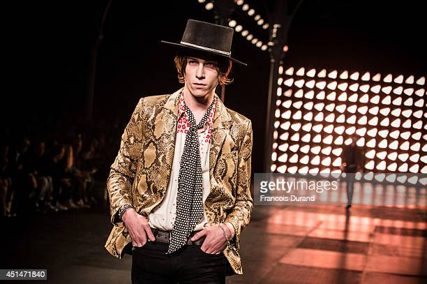 A model walks the runway during the Saint Laurent show as part of the Paris Fashion Week Menswear Spring/Summer 2015 on June 29 2014 in Paris France